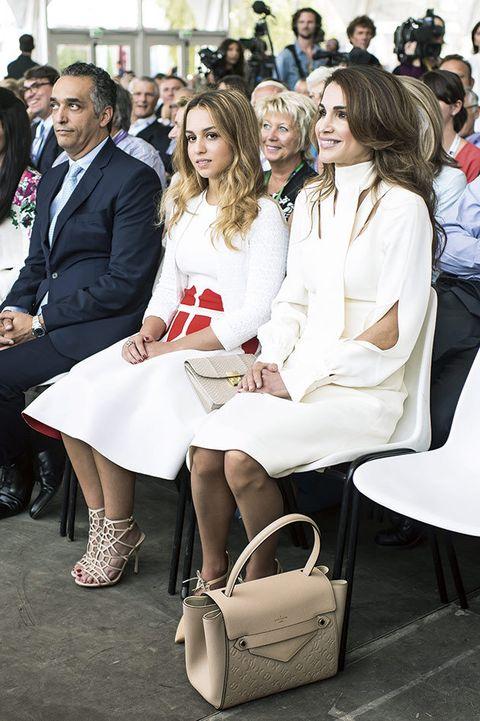 Fashion, Event, Uniform, Leg, Dress, Street fashion, Sitting, Smile, White-collar worker, Thigh,
