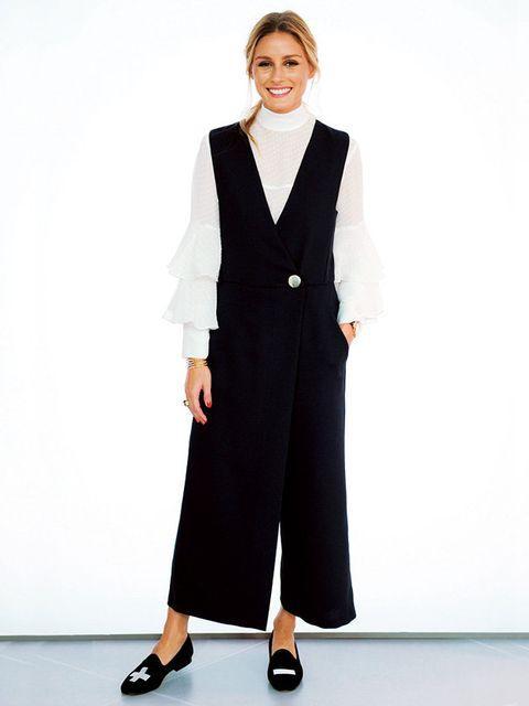 Clothing, Suit, Formal wear, Outerwear, Fashion, Standing, Tuxedo, Pantsuit, Neck, Blazer,