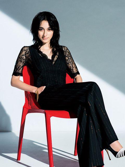 Fashion model, Clothing, Photo shoot, Sitting, Leg, Fashion, Thigh, Dress, Fashion design, High heels,
