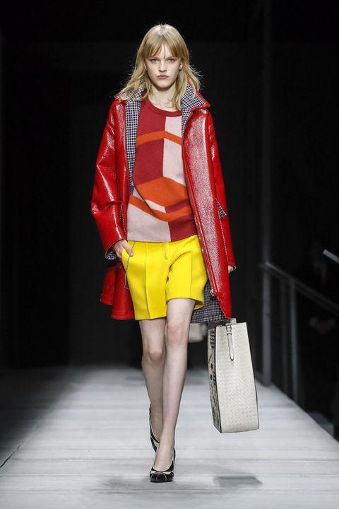 Fashion model, Fashion, Fashion show, Runway, Clothing, Yellow, Fashion design, Public event, Event, Outerwear,