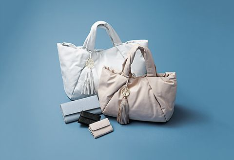 Bag, White, Handbag, Fashion accessory, Shoulder bag, Beige, Diaper bag, Material property, Still life, Luggage and bags,