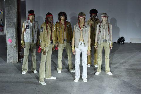 Military uniform, Uniform, Standing, Fashion, Military, Military organization, Fashion design, Troop, Infantry, Soldier,