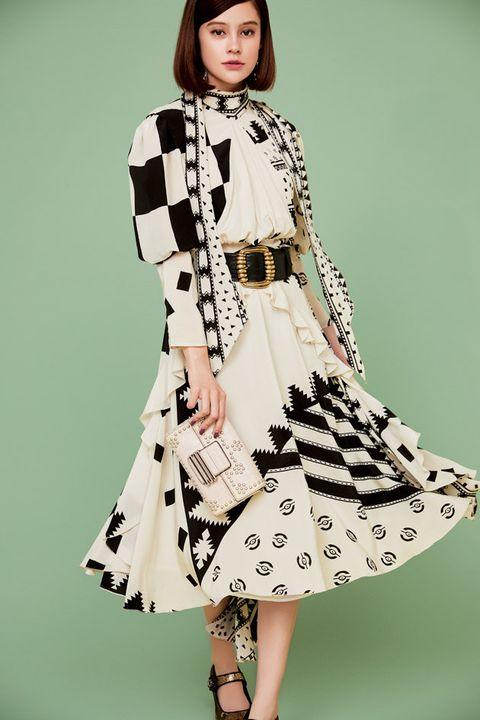 Fashion model, Clothing, Fashion, Dress, Sleeve, Waist, Outerwear, Day dress, Fashion design, Trench coat,