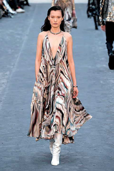 Clothing, Fashion show, Shoulder, Joint, Human leg, Fashion model, Dress, Runway, Style, Street fashion,