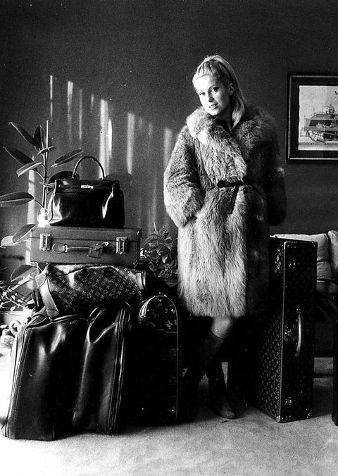 Photograph, Fur, Black-and-white, Fur clothing, Retro style, Photography, Vintage clothing, Room, Classic, Baggage,