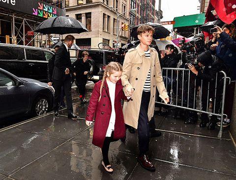 Street fashion, Pedestrian, Snapshot, Fashion, Street, Event, Luxury vehicle, Vehicle, Outerwear, Coat,