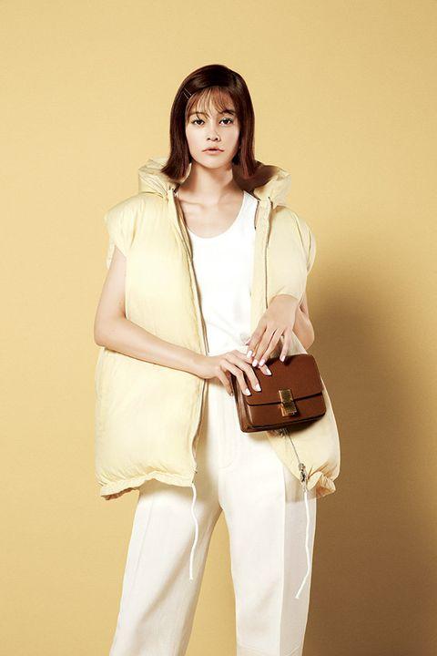 White, Clothing, Shoulder, Beige, Fashion, Fashion model, Waist, Outerwear, Joint, Neck,