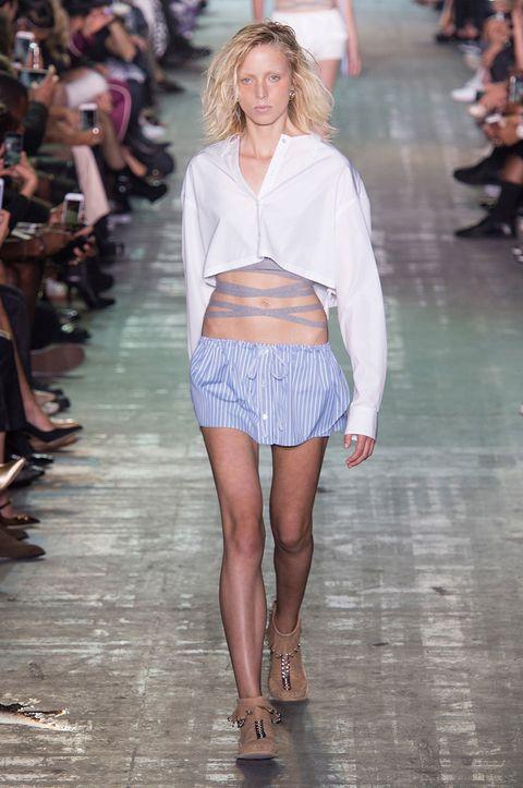Clothing, Leg, Fashion show, Human body, Human leg, Shoulder, Runway, Joint, Style, Fashion model,