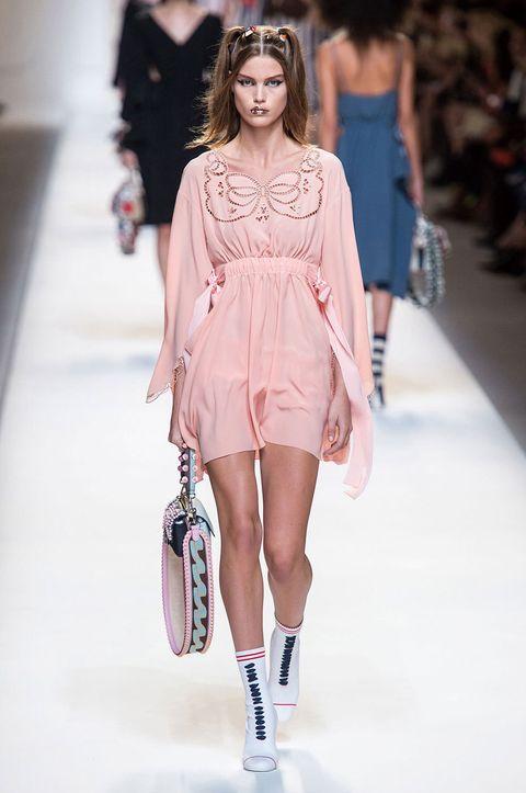 Clothing, Leg, Fashion show, Shoulder, Human leg, Runway, Joint, Fashion model, Style, Dress,