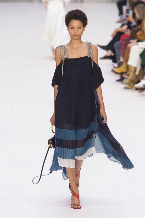 Dress, Shoulder, Fashion show, Human leg, Joint, Style, Waist, One-piece garment, Jewellery, Runway,