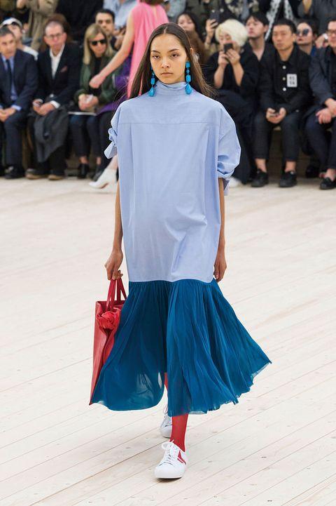 Clothing, Sleeve, Shoulder, Style, Street fashion, Fashion, Waist, Bag, Electric blue, Public event,