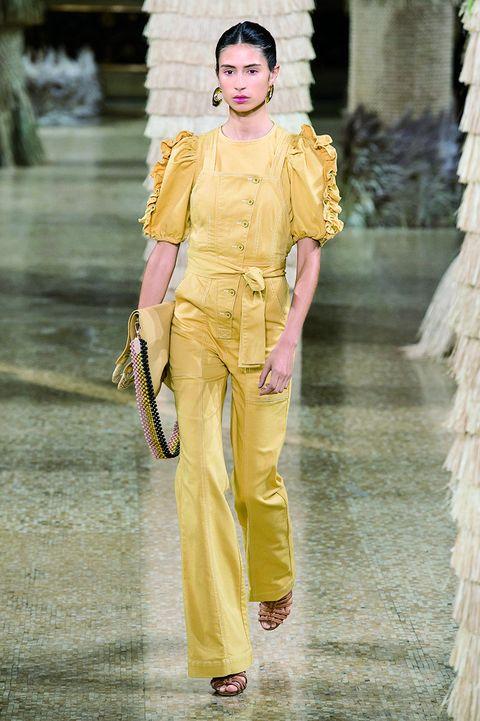Fashion model, Fashion, Clothing, Yellow, Runway, Fashion show, Haute couture, Fashion design, Shoulder, Outerwear,