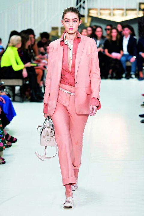 Fashion model, Fashion, Fashion show, Runway, Clothing, Pink, Suit, Pantsuit, Blazer, Haute couture,