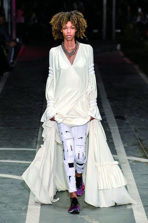Fashion model, Fashion, White, Clothing, Fashion show, Runway, Street fashion, Haute couture, Fashion design, Outerwear,