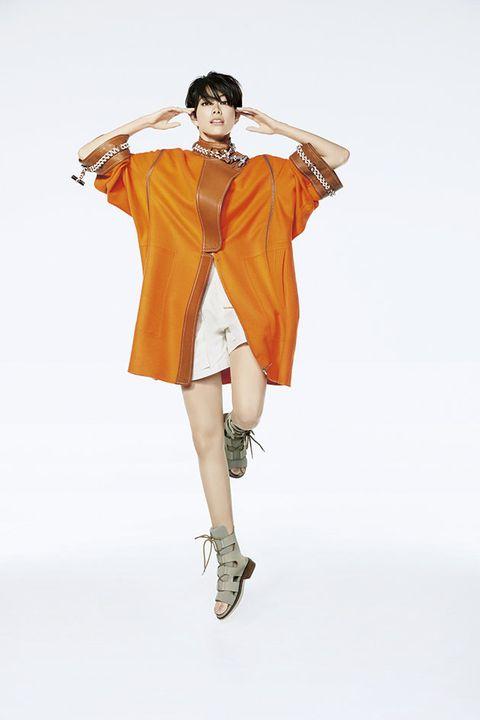 Fashion model, Orange, Clothing, Yellow, Fashion, Fashion design, Shoulder, Outerwear, Joint, Footwear,