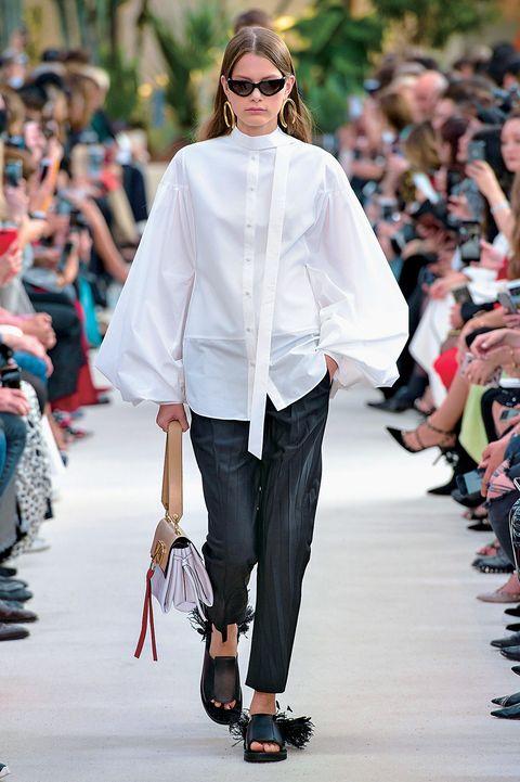 Fashion, Fashion show, Fashion model, Runway, Clothing, White, Street fashion, Shoulder, Outerwear, Eyewear,