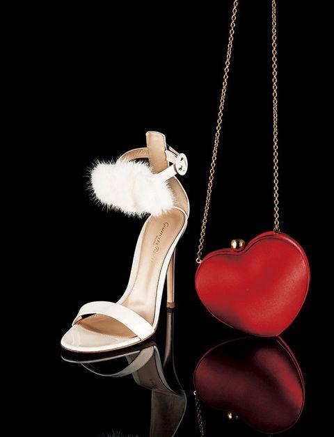 Footwear, Leg, High heels, Still life photography, Shoe, Fashion accessory, Ornament, Heart, Jewellery, Pendant,