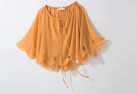 Clothing, Orange, Yellow, Blouse, Shoulder, Joint, Poncho, Peach, Outerwear, Beige,