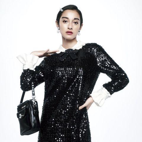 Clothing, Black, Sleeve, Dress, Shoulder, Fashion model, Neck, Cocktail dress, Fashion, Joint,