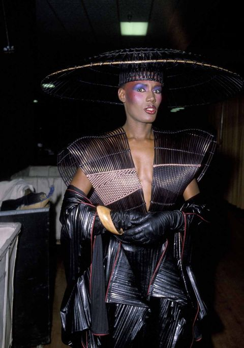 Fashion, Latex clothing, Latex, Dress, Costume, Leather, Hat, Model, Black hair,