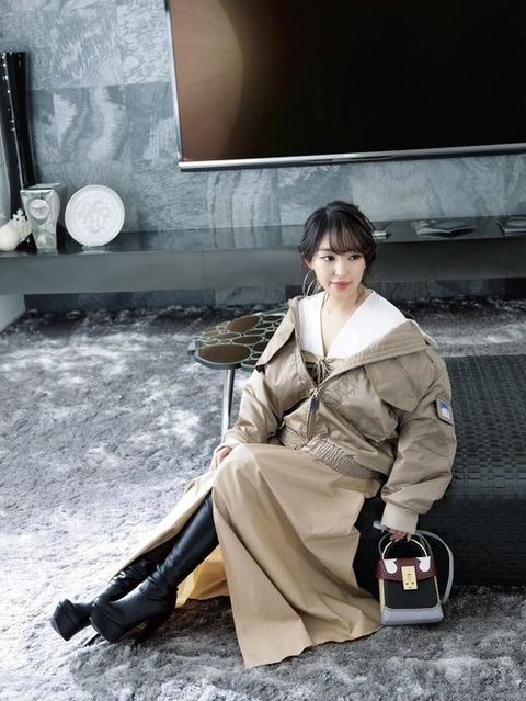 Sitting, Costume, Photography, Street fashion, Black hair,