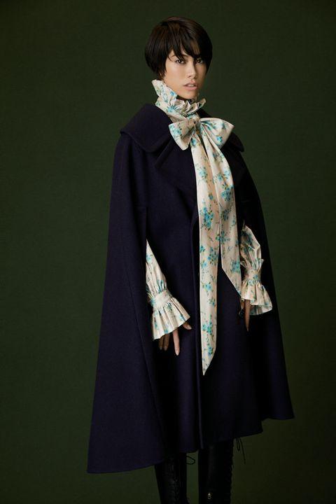 Clothing, Outerwear, Fashion, Costume, Coat, Cape, Mantle, Fashion accessory, Formal wear, Cloak,