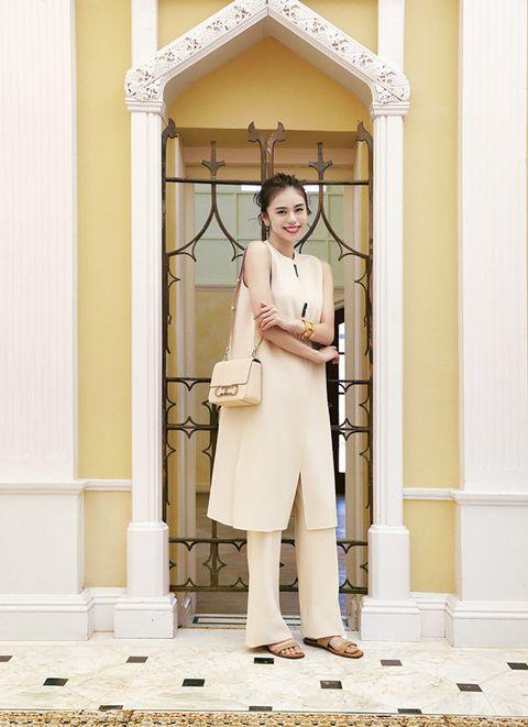 White, Photograph, Trench coat, Yellow, Fashion, Coat, Street fashion, Uniform, Outerwear, Room,