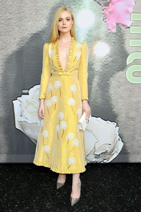 Clothing, Fashion model, Dress, Yellow, Fashion, Blond, Haute couture, Cocktail dress, Shoulder, Leg,