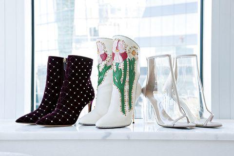 Footwear, Boot, Vase, Shoe, Design, Glass, Room, Furniture, Interior design, Table,