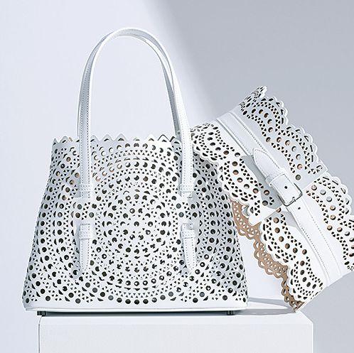 Handbag, Bag, Fashion accessory, Shoulder bag, Font, Silver, Metal,