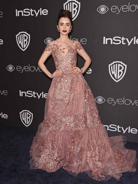 Dress, Clothing, Gown, Fashion model, Shoulder, Carpet, Red carpet, Fashion, Flooring, Hairstyle,