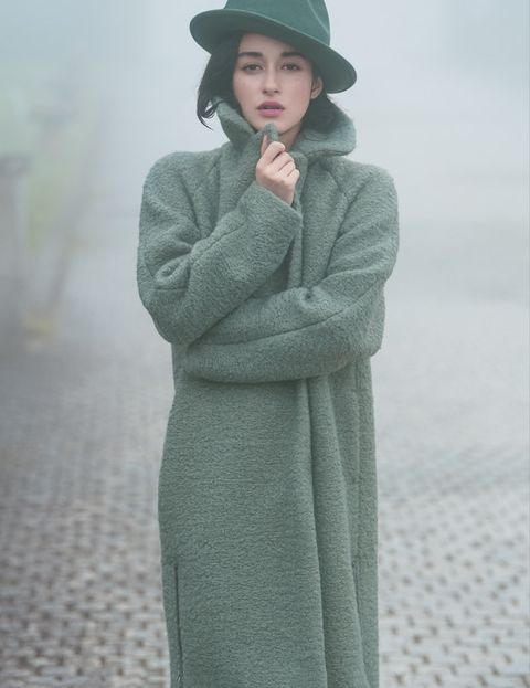 Clothing, Outerwear, Standing, Overcoat, Coat, Wool, Headgear, Sleeve, Robe, Dress,