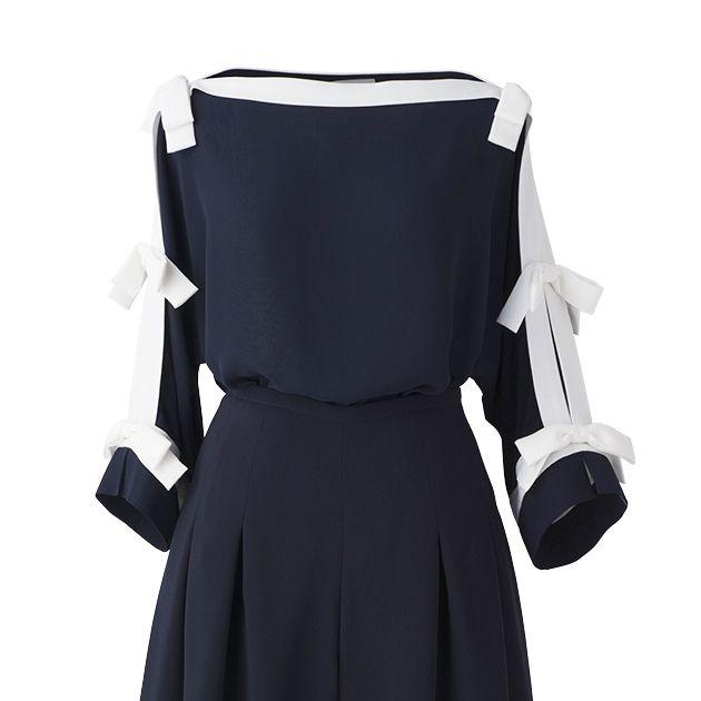 Sleeve, Collar, Black, Day dress, One-piece garment, Costume, Costume design, Fashion design, Pattern, Button,