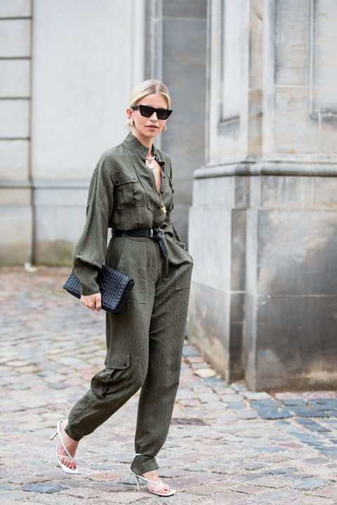 Street fashion, Clothing, Fashion, Standing, Suit, Outerwear, Footwear, Trousers, Sunglasses, Shoe,