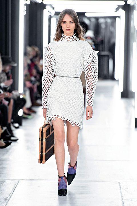 Fashion model, Fashion, Fashion show, Runway, White, Clothing, Shoulder, Haute couture, Street fashion, Dress,