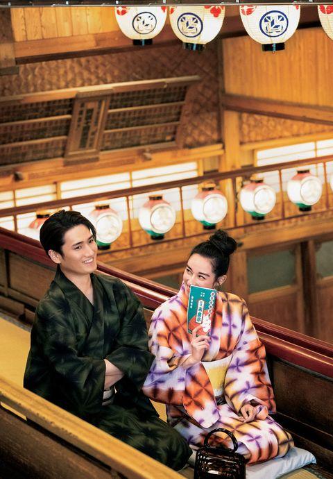 Camera, Single-lens reflex camera, Sitting, Temple, Black hair, Camera lens, Reflex camera, Digital camera, Kimono, Snapshot,