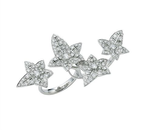 White, Metal, Brooch, Silver, Body jewelry, Wing, Chemical substance, Platinum,