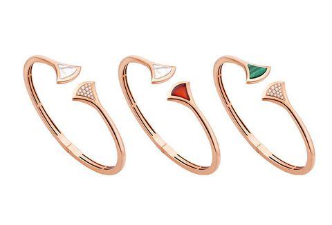 Fashion accessory, Jewellery, Font, Metal, Silver, Earrings, Ear, Body jewelry,