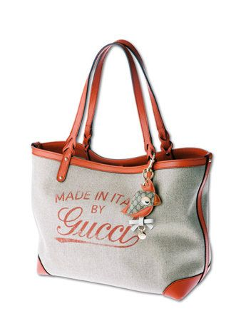 Product, Brown, Bag, Red, White, Fashion accessory, Style, Font, Luggage and bags, Shoulder bag,