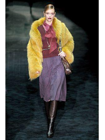 Textile, Outerwear, Fur clothing, Boot, Jacket, Fashion, Costume design, Fashion model, Fashion show, Knee,