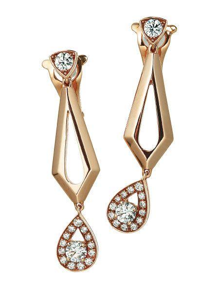 Metal, Award, Body jewelry, Earrings, Analog watch, Symbol, Silver, Chain,