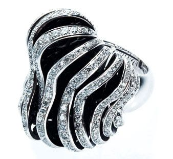 Jewellery, Metal, Natural material, Body jewelry, Gemstone, Black-and-white, Silver, Monochrome photography, Chemical substance, Platinum,