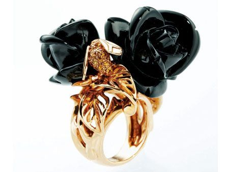 Amber, Orange, Natural material, Body jewelry, Confectionery, Craft, Still life photography, Artificial flower, Knot,