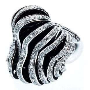 Jewellery, Fashion accessory, Natural material, Metal, Body jewelry, Gemstone, Silver, Black-and-white, Mineral, Chemical substance,