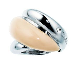 Product, Metal, Beige, Ring, Gemstone, Natural material, Mineral, Silver, Oval, Chemical substance,