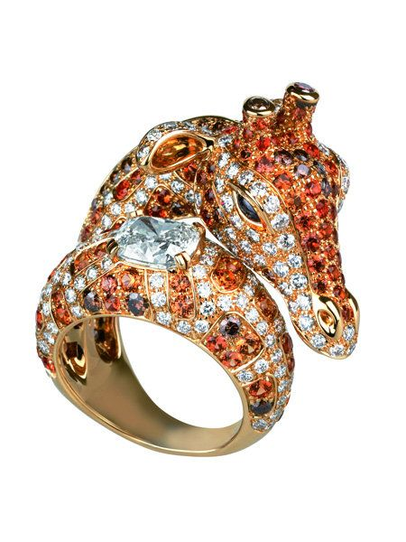 Amber, Metal, Jewellery, Gemstone, Body jewelry, Circle, Natural material, Silver, Mineral, Chemical substance,