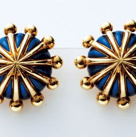 Metal, Pattern, Circle, Body jewelry, Bronze, Silver, Brass, Symmetry, Household hardware, Natural material,