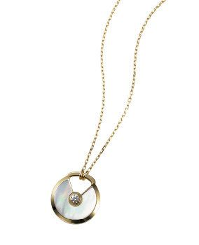 Jewellery, Fashion accessory, Metal, Locket, Pendant, Circle, Silver, Necklace, Body jewelry, Natural material,