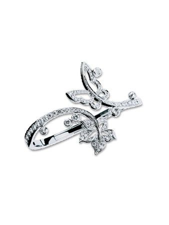 Jewellery, Metal, Engagement ring, Ring, Pre-engagement ring, Body jewelry, Brooch, Silver, Mineral, Platinum,