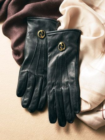 Finger, Safety glove, Glove, Personal protective equipment, Thumb, Gesture, Law enforcement, Leather, Formal gloves,